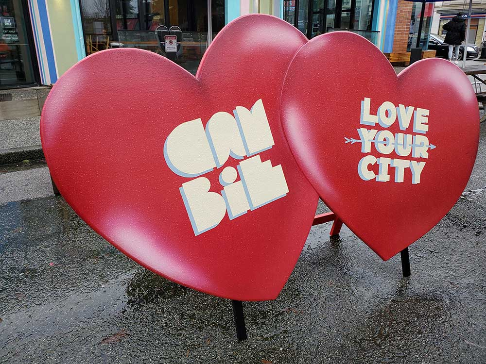 LOVE YOUR CITY CONTEST Cambie Village, the Heart of Vancouver, wants you to feel the love! The Cambie Village Business Association is pleased to join 15 other BIAs (or Business Districts) across Vancouver to host a month-long campaign of finding love while exploring Vancouver. For the month of February, Vancouverites can explore these neighbourhoods looking for the heart installations, taking photos or selfies, and posting them online. Cambie Village has installed a giant 4ft x 7ft pair of hearts at the Cambie Village Plaza on W.18th. (installation taking place on February 1st in the morning) In addition, Cambie Village will have a half dozen more instagrammable hearts along Cambie, plus the existing heart mural near the Canada Line King Edward station. Snap and post your photos, and use the hashtag #LoveYourCity for a chance to win the city-wide grand prize worth up to $5000! Tag #CambieVillage for a chance to win one of our local prizes including Biercraft gift cards, Winners/HomeSense gift cards, and more! Like and follow us on Facebook and Instagram to find out if you have won. Post soon and post often to increase your chances to win. facebook/cambievillage or @CambieVillage and @loveyourcitycontest